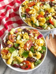 two bowls of greek pasta salad