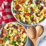 two bowls of healthy greek pasta salad