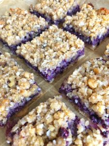 plate of mixed berry crumble bars