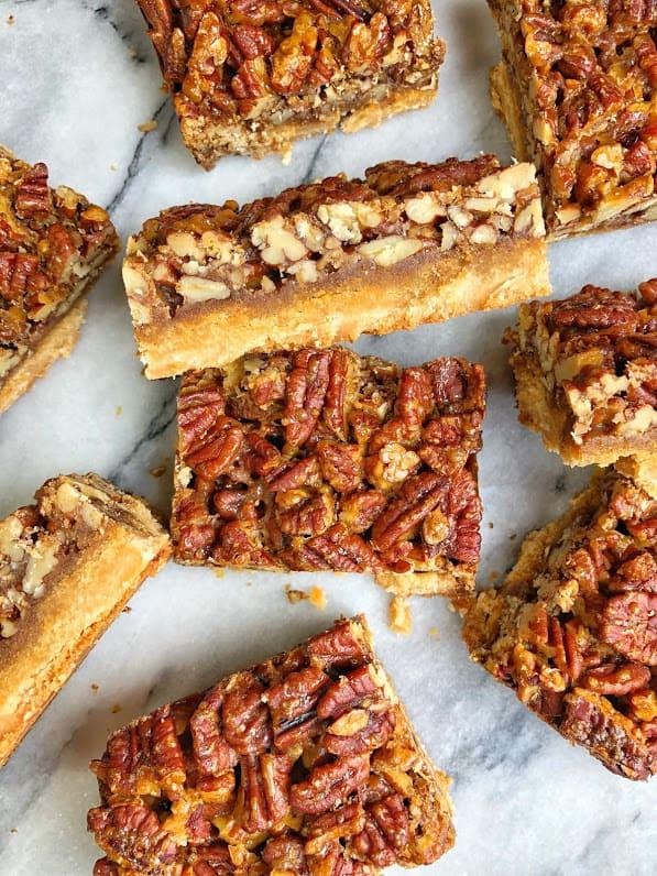 healthy pecan pie bars on a marble slab