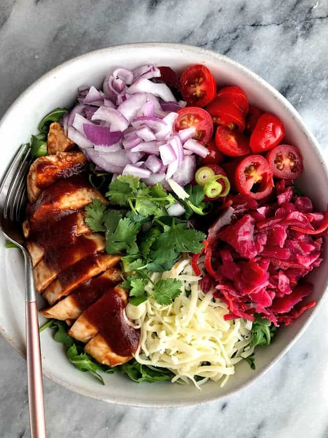 salad bowl with chicken, cheese, onions, tomatoes