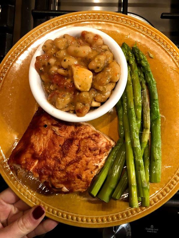 salmon, asparagus, chili on a plate