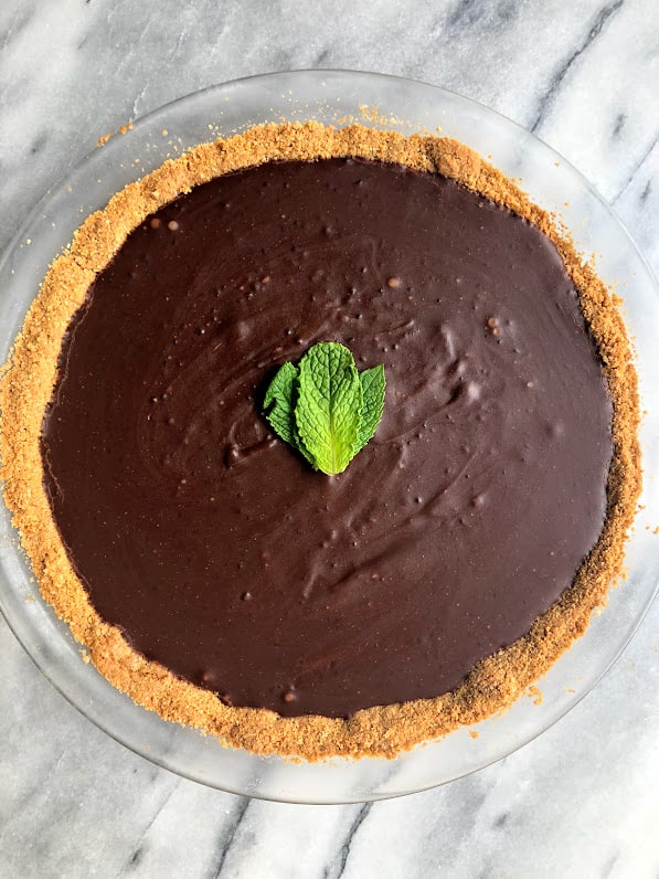 vegan mint chocolate tart in a pie dish