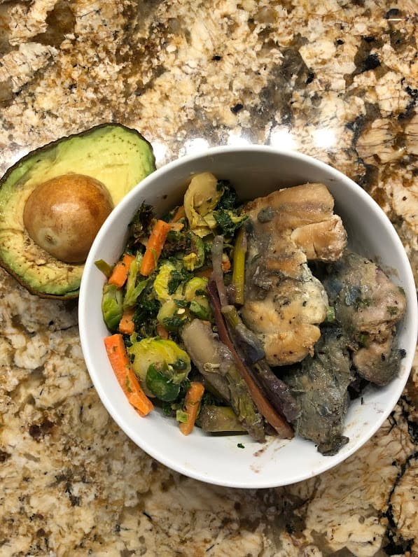 brussel sprouts, carrots, kale and almond butter sauce with chicken and avocado