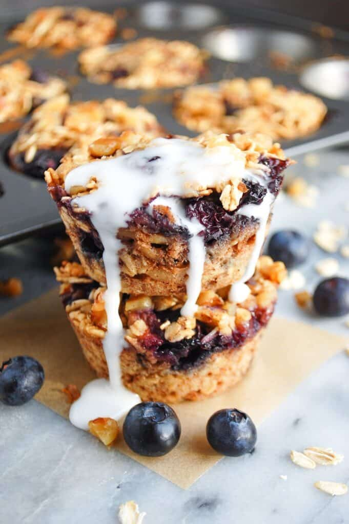 stack of baked blueberry muffins with icing