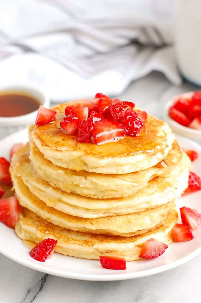 side shot stack of fluffy paleo pancakes with syrup