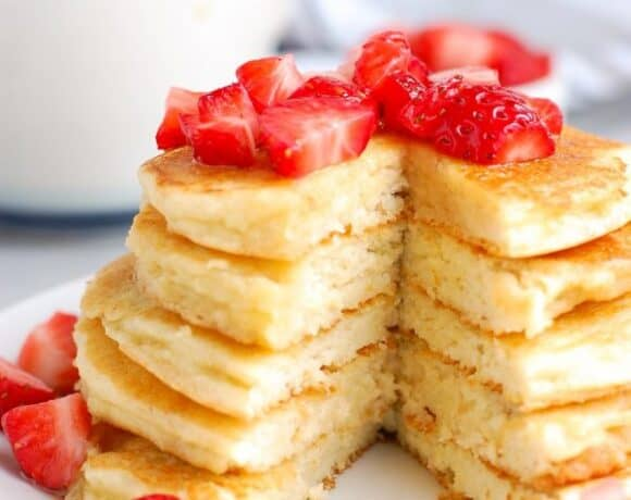 stack of paleo pancakes with slice