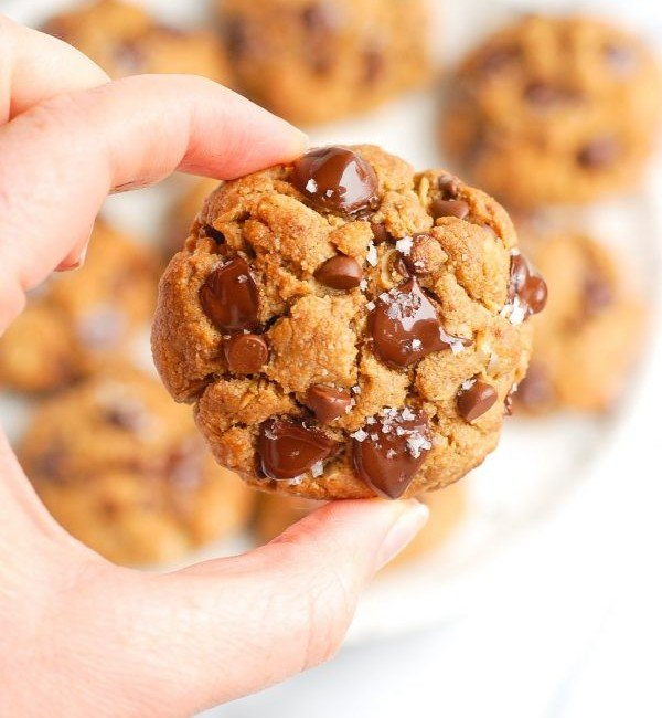 holding peanut butter oatmeal cookie