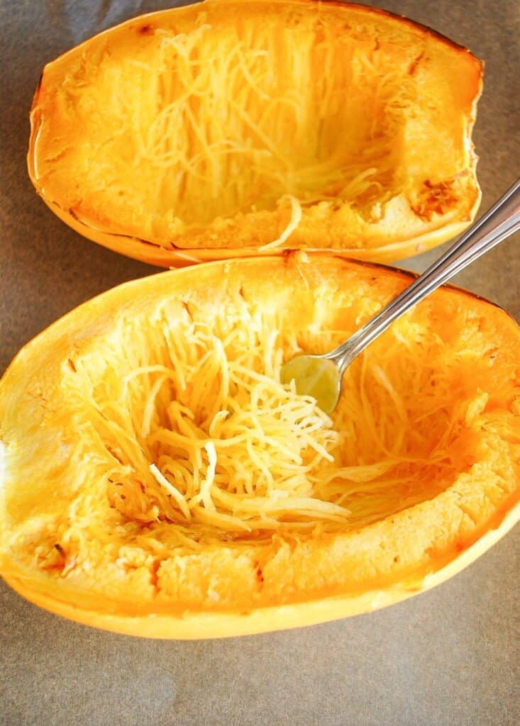two spaghetti squash boats with strands