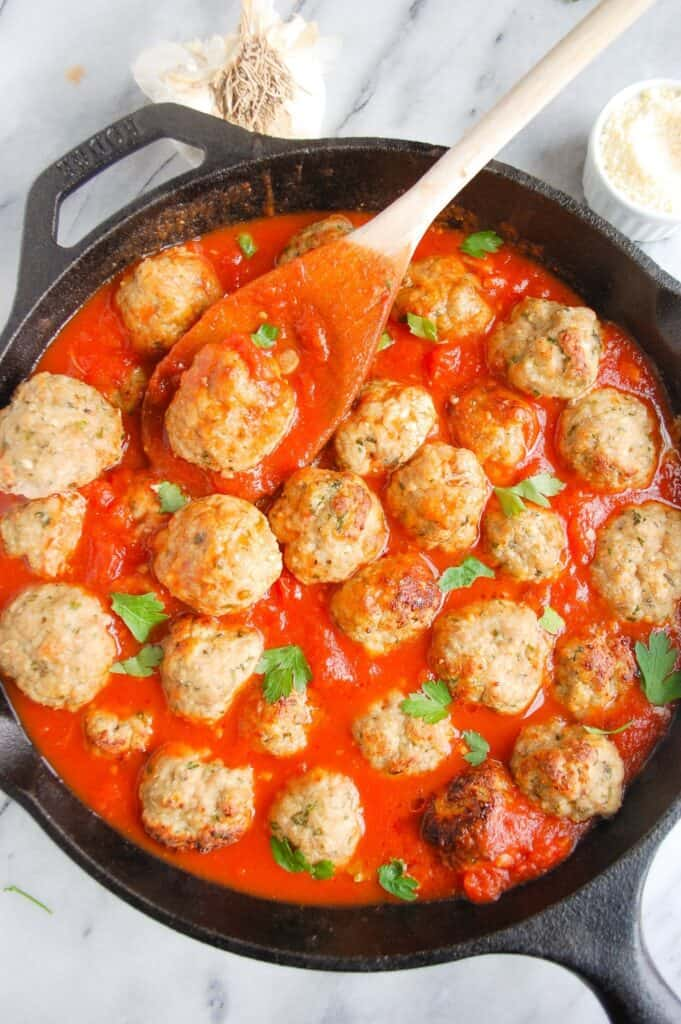 skillet of easy turkey meatballs with spoon