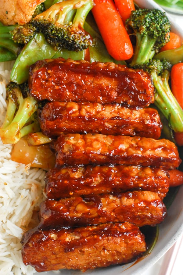 bbq baked tempeh in dish with veggies