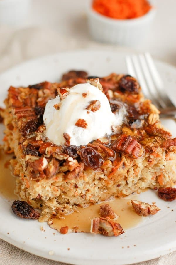 slice of carrot cake baked oatmeal with syrup drip