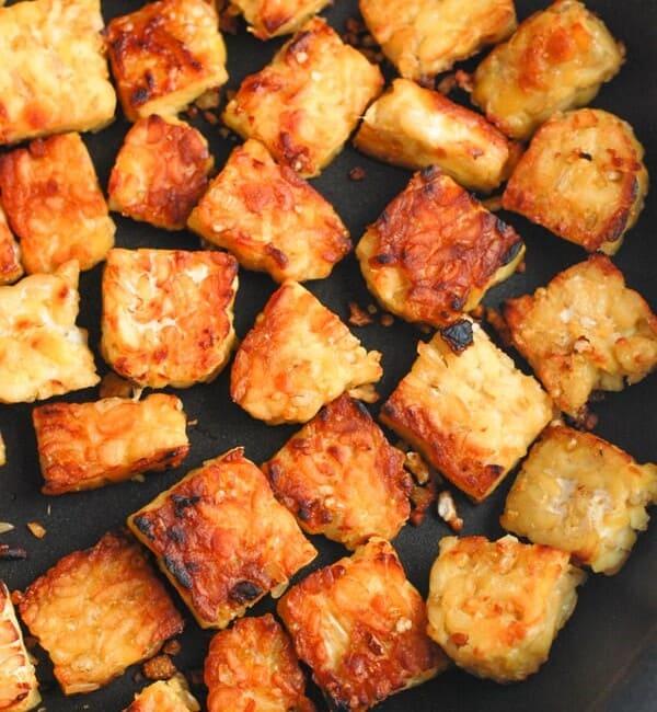 cut up tempeh in pan