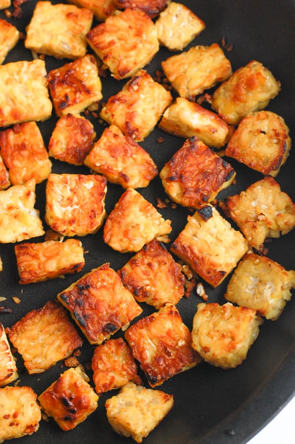 cut up tempeh in pan