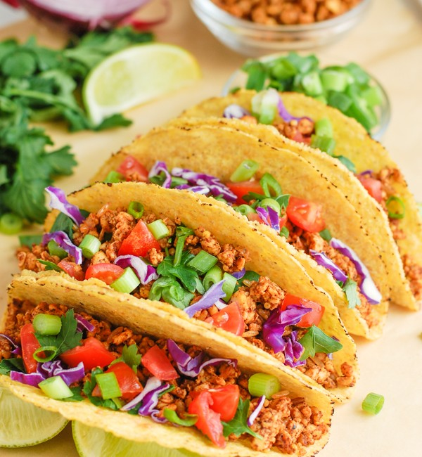 tacos stacked in a row