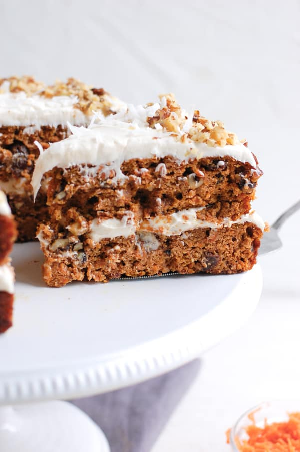 slice of carrot cake on cake stand