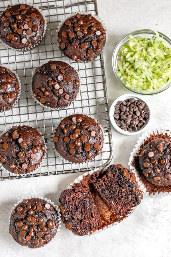 chocolate muffin cut in half with zucchini shreds and chocolate chips