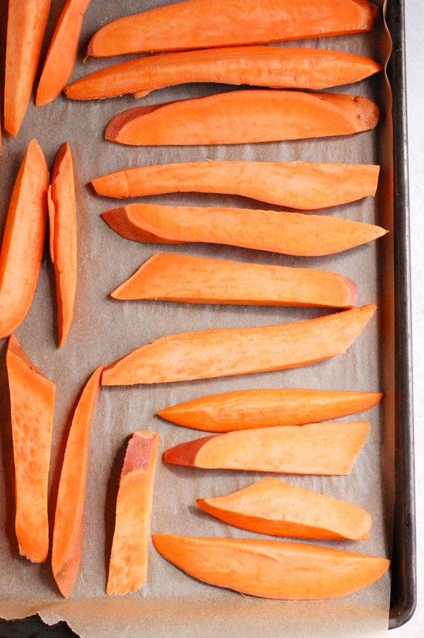 sweet potato wedges on tray