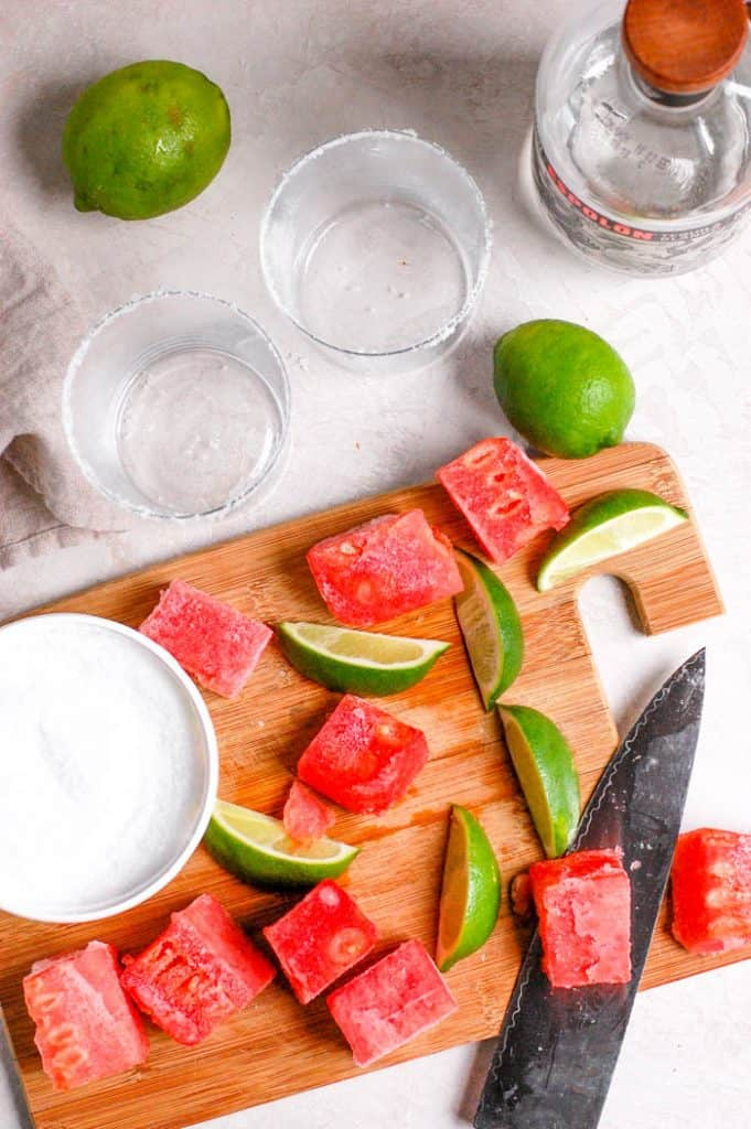 watermelon, limes, glasses, and a knife
