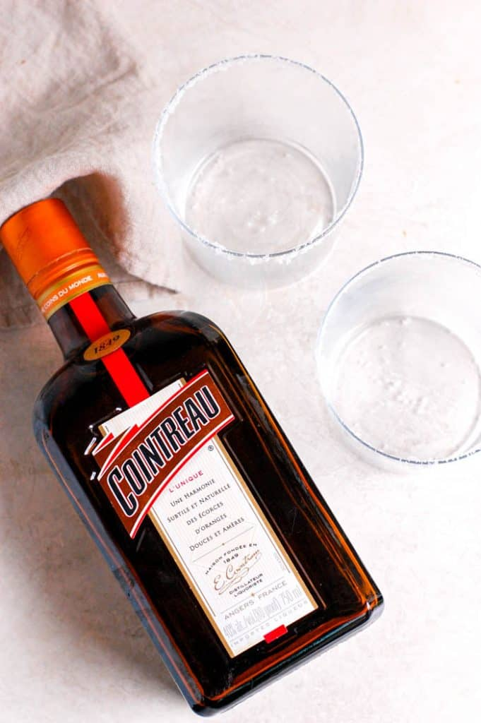 bottle of cointreau next to glasses