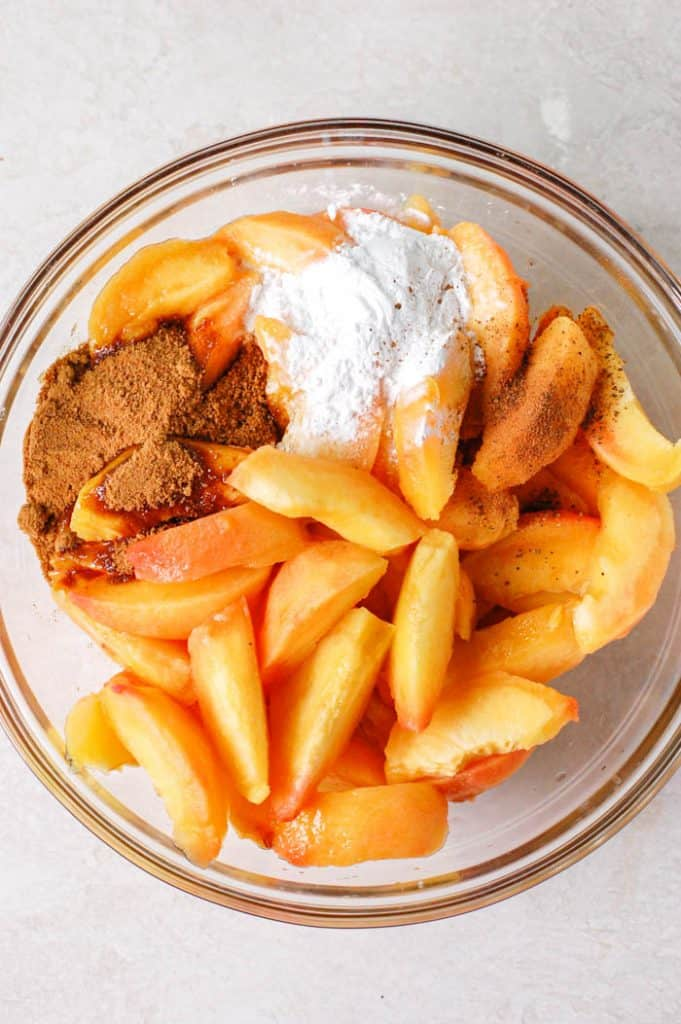 peaches with coconut sugar and starch in a bowl