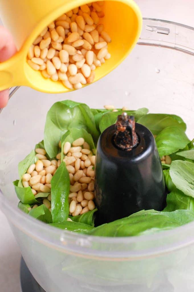 pine nuts and basil in food processor