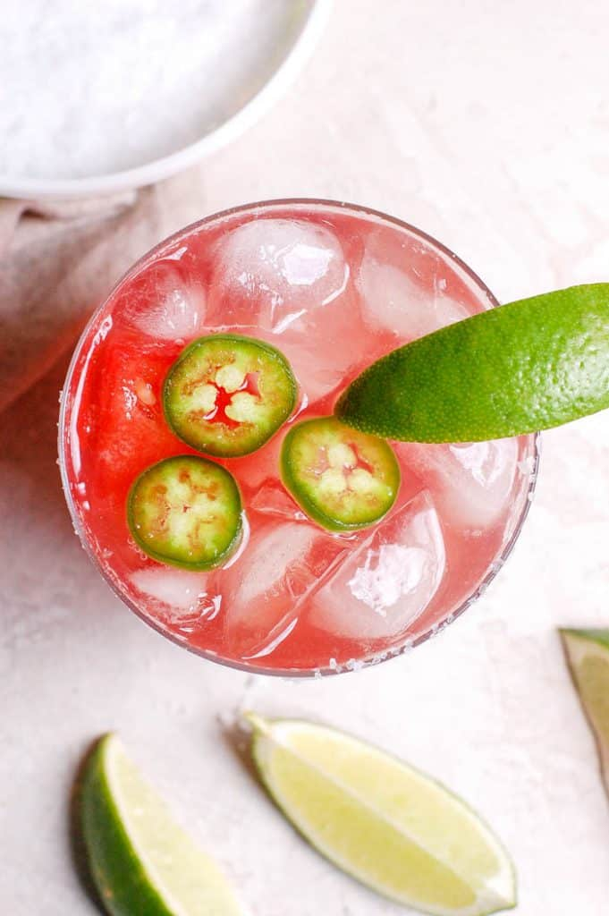 jalapenos in a margarita with lime and ice