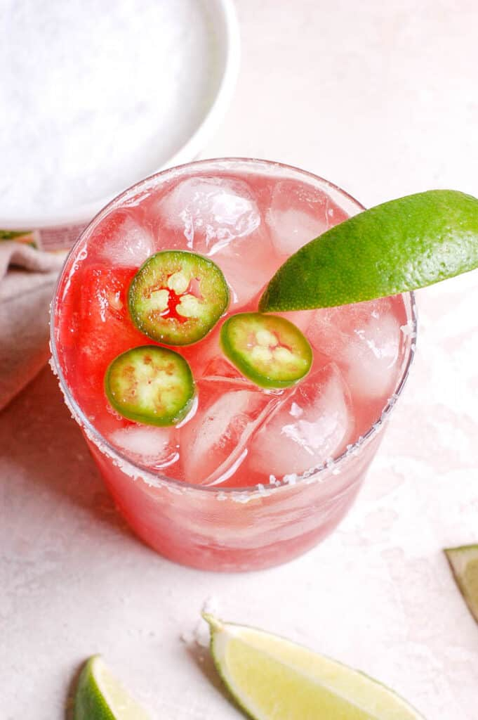 jalapenos in a glass with lime and ice