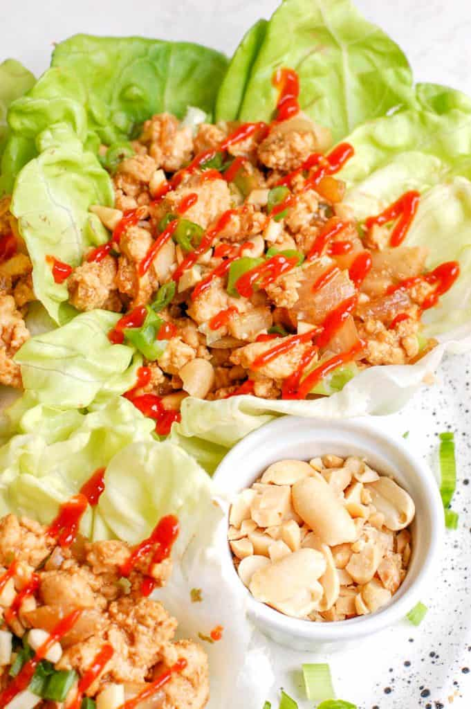 plate of chicken lettuce cups with peanuts