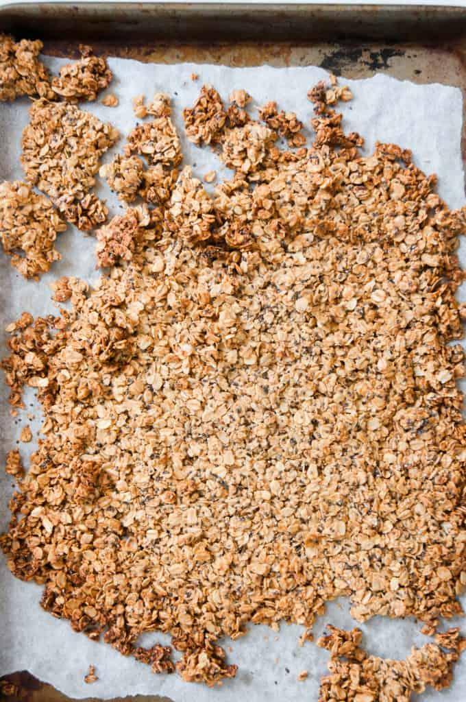 almond butter granola on sheet