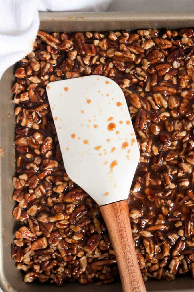 caramel pecans and spatula