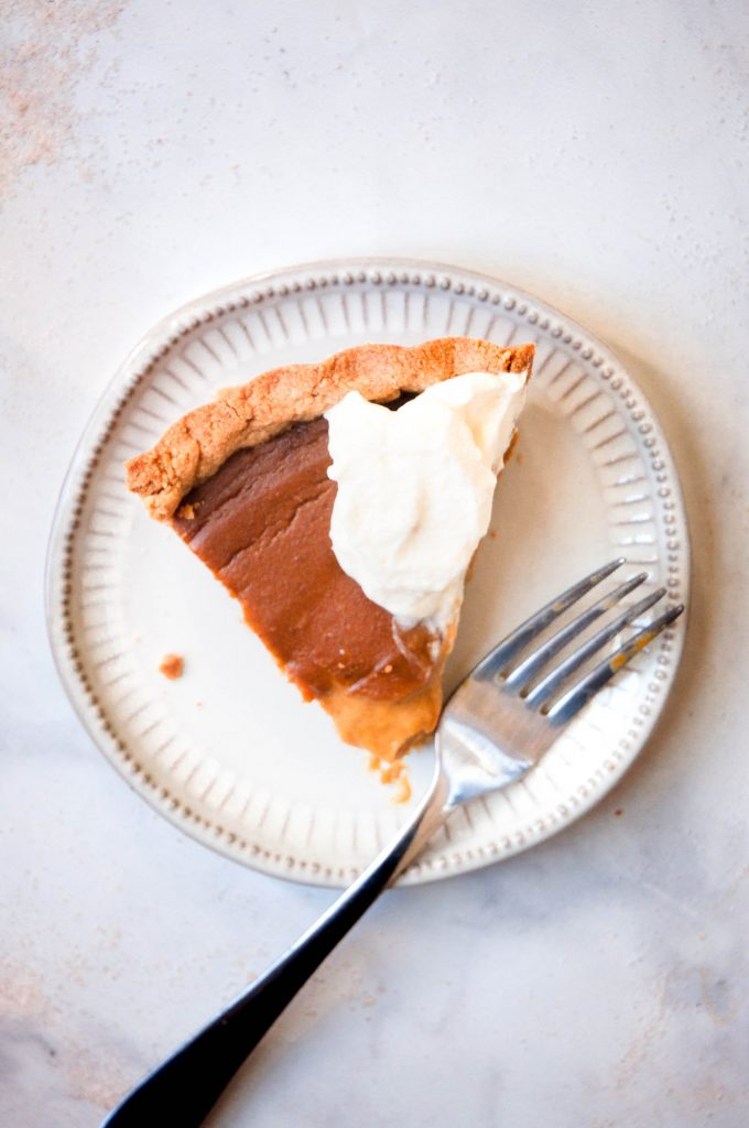 slice of healthy pumpkin pie on plate
