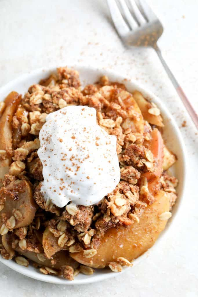 apple crisp in bowl with fork