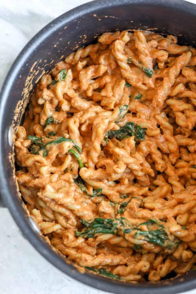 creamy pasta in a saucepan