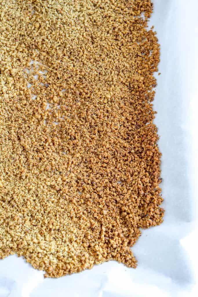 walnut breadcrumbs on baking sheet