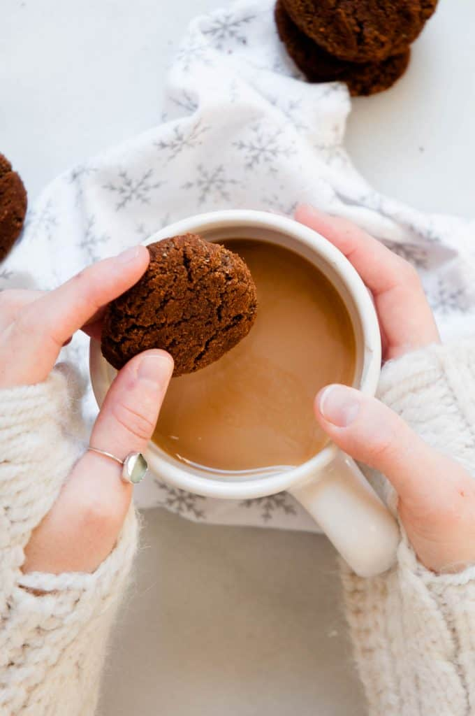 dipping gingersnap into coffee