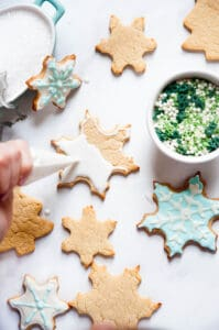 decorating a sugar cookie