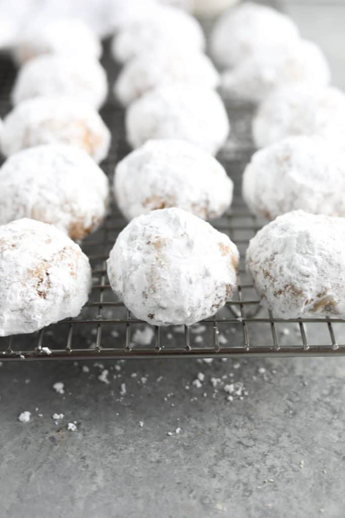 snowball cookies on rack