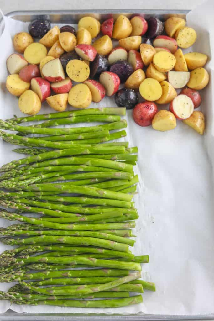 asparagus and potatoes on baking sheet