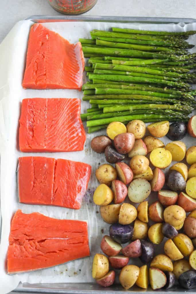 salmon, potatoes, asparagus on baking sheet