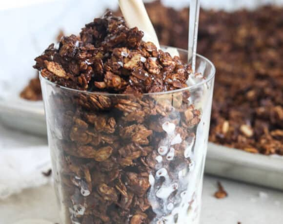 chocolate granola in cup with milk