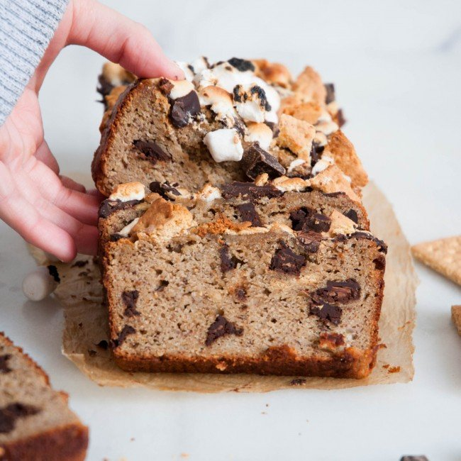 hand grabbing slice of smores banana bread