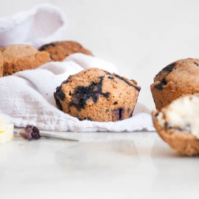 blueberry muffin on cloth napkin