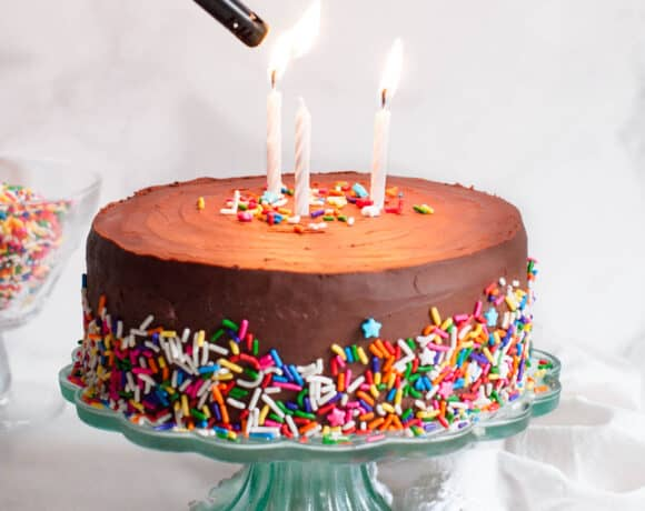 lighting candles on healthy birthday cake