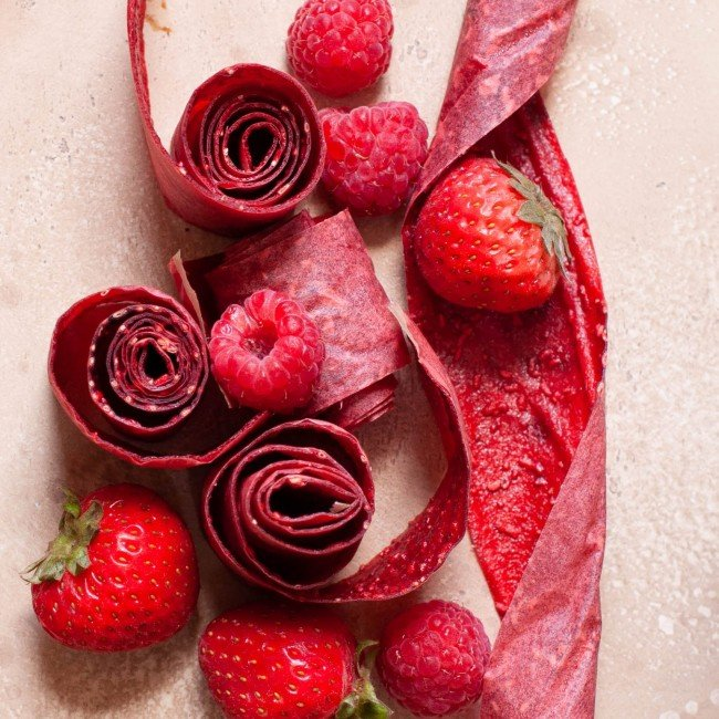 healthy homemade fruit roll ups with strawberries and raspberries
