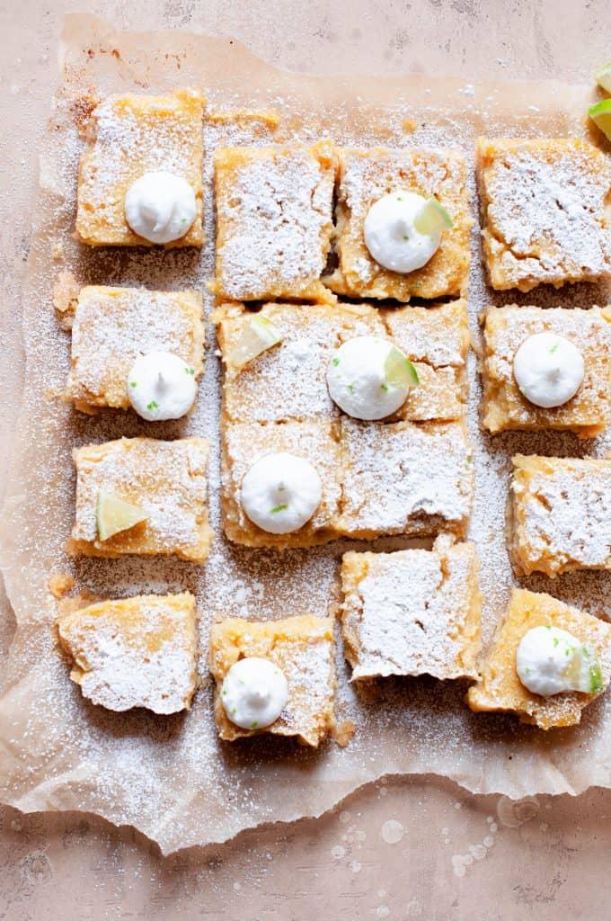 healthier key lime pie bars on parchment paper