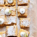 tray of healthier key lime pie bars with powdered sugar