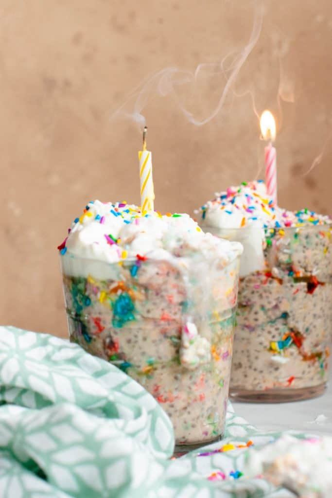 birthday cake overnight oats in cup with candle