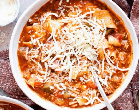 lasagna soup in bowl with spoon and cheese