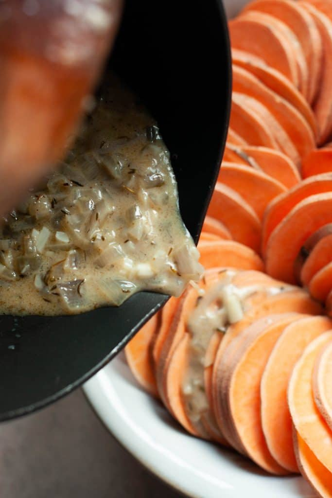 pouring butter on sweet potatoes
